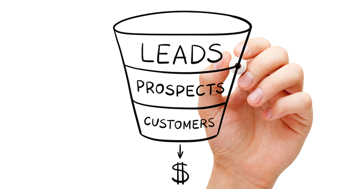 Someone hand drawing with texta a lead funnel, showing leads at the top then prospects and customers.